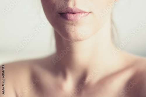 Fotografie, Obraz Closeup of young woman's pink lips and neck