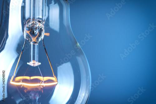 Fotografija Close up glowing light bulb