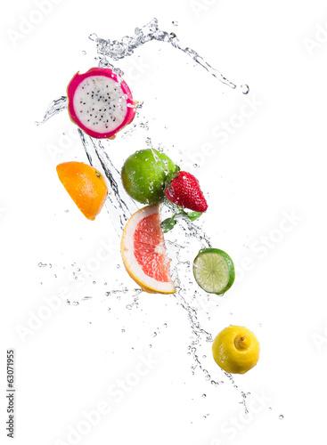 Pieces of exotic fruit in water splash