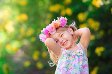 Happy Smiling Child With Flower At Summer Day Outdoor