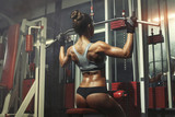 Woman engaged in the simulator in the gym - 63095971