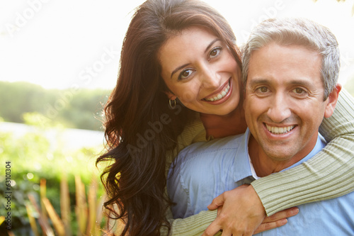 Portrait Of Loving Hispanic Couple In Countryside Canvas Print