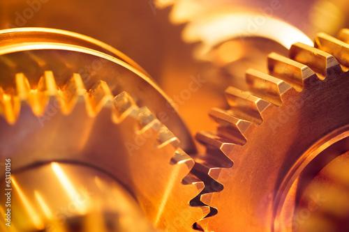 Fotografie, Obraz  golden gear wheels, close-up