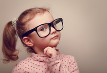 Thinking Kid Girl In Glasses Looking. Instagram Effect Portrait