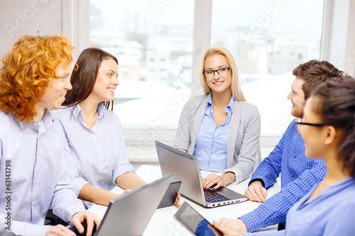 Fototapeta smiling team with laptop and table pc computers obraz na płótnie