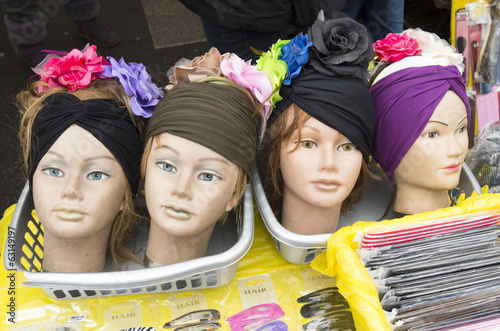 Photo  Doll heads with hair decoration on the Albert Cuyp market in Ams