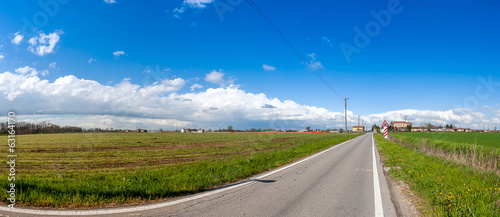 Foto op Aluminium Blauw road in the middle of the countryside