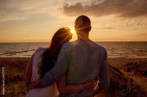 Photo  couple sundown sea