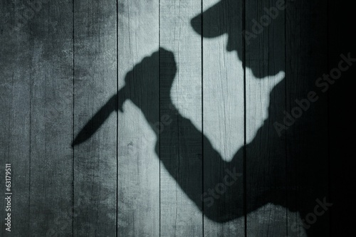 Photo Human Silhouette with Knife in shadow on wooden background, XXXL