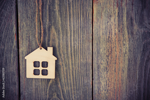 Fotografia, Obraz  house as symbol on wooden background