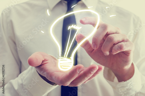 Fotografie, Obraz  Businessman with creative light bulb icon