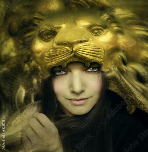 Beautiful young woman with lion mask