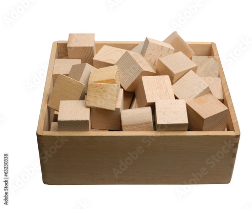 Box of wooden bricks isolated - Buy this stock photo and explore
