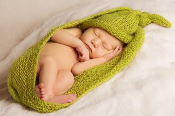 Fototapeta samoprzylepna baby newborn portrait, kid sleeping in green woolen blanket