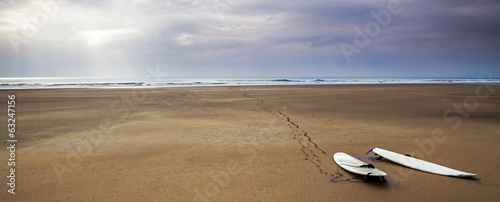 Surfboards on the sand, beach and surfing landscape with beautif Canvas Print