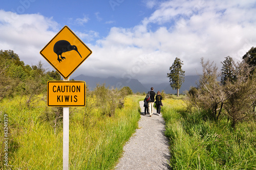 Tuinposter Nieuw Zeeland Caution kiwi panel on a trail - New Zealand