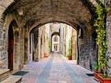 Arched medieval street in the town of Assisi, Italy