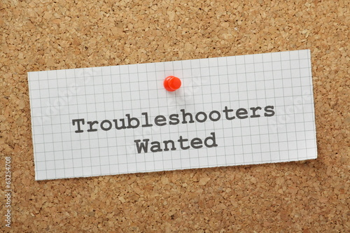 Fotografía  Troubleshooters Wanted on a cork notice board