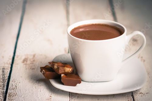 Poster Chocolate Cup of hot chocolate on wooden background