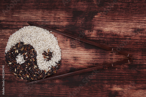 Fotografie, Obraz  Black and white rice forming a yin yang symbol.