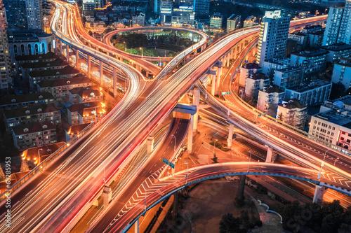 Fotobehang Nacht snelweg closeup of the modern city viaduct junction