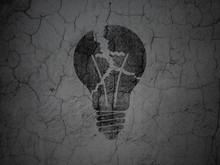 Business Concept: Light Bulb On Grunge Wall Background