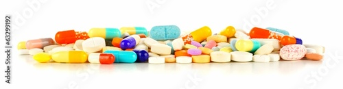 Foto Long pile of assorted pills forming a border