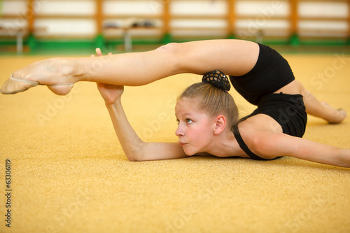 Young gymnast train your body Wallpaper Mural