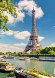 Eiffel tower in Paris, France. Beautiful view of Seine river in summer.