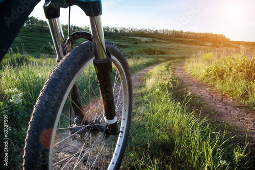 Photo Stands Cycling riding bicycle in summer