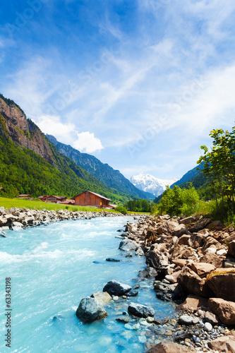 Fotobehang Landschap Beautiful Swiss landscape with river stream