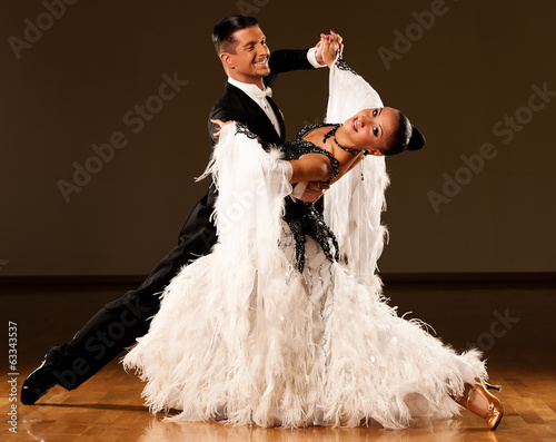 Professional ballroom dance couple preform an exhibition dance Canvas Print