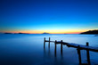 Wooden jetty with seascape during sunet