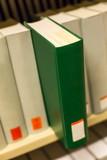 a plain book in a bookshelf