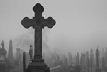 A Cross In Ancient An Graveyard