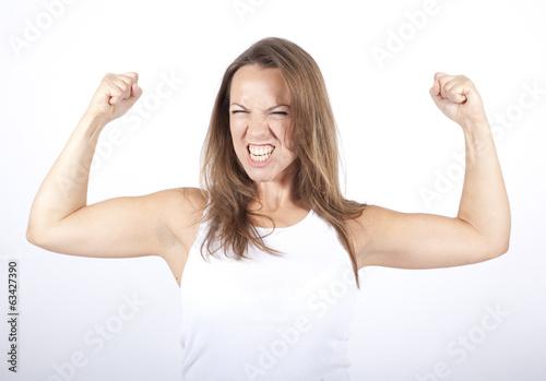 Valokuva  Frau zeigt Muskeln