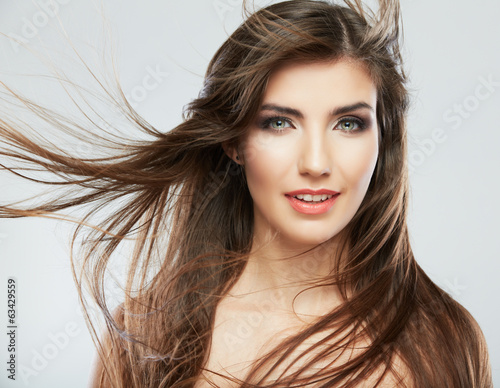 Woman face with hair motion on white background