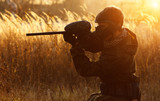 Paintball sport player at sunset