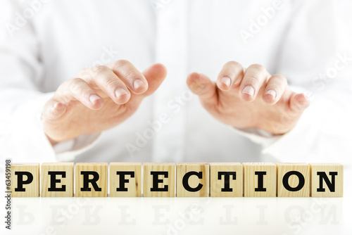 Fotografía  Imagen conceptual con la palabra perfección