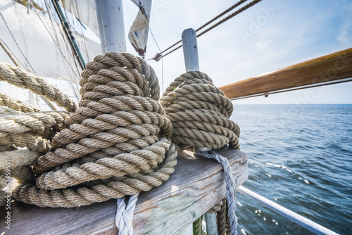 Wooden pulley and ropes on old yacht.