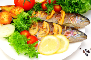 Fototapetagrilled trout with fresh herbs, vegetables and lemon