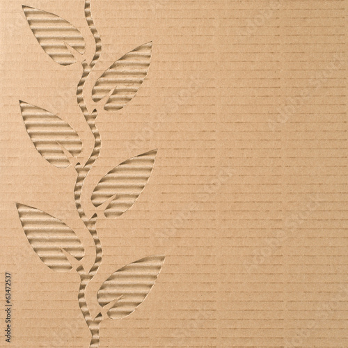 Fotografía  Leaves cut out on a corrugated cardboard