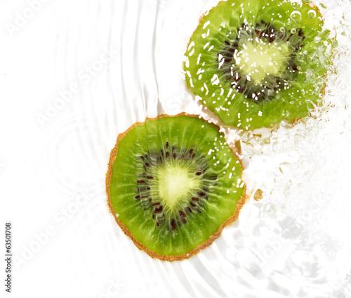 Recess Fitting Splashing water juicy kiwi fruit in water on a white background. macro