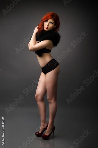 9457d1a51 Studio portrait of a confident curvy woman posing in lingerie - Buy ...