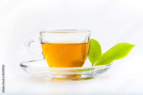 Staande foto Thee Green tea leaf and glass cup of black tea isolated on white back