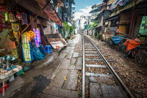 Railway crossing the street in city, Vietnam.