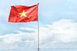 Leinwanddruck Bild - Red national flag of Vietnam waving in blue sky.