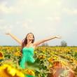 Woman summer girl happy in sunflower flower field