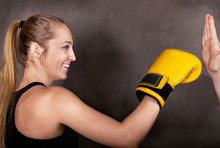 Female Boxer Practicing In The Boxing Ring