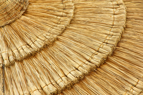 Photo sur Toile Les Textures straw beach umbrella close-up
